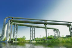 Industrial pipelines on pipe-bridge. Against blue sky Stock Images