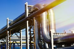 industrial pipe-bridge against blue sky Stock Photos