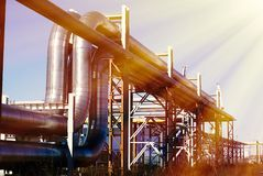 Industrial pipelines on pipe-bridge against blue sky Royalty Free Stock Image