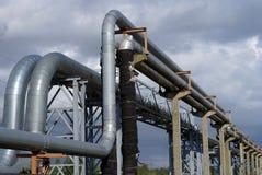 Industrial pipelines on pipe-bridge against sky Royalty Free Stock Photo