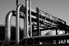 Industrial pipelines and storage tanks b&w Stock Photo
