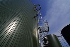 Industrial pipelines and tanks against blue sky Royalty Free Stock Image