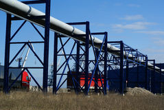 Industrial pipelines and trucks Stock Images