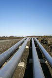 Industrial pipelines in vulcanic landscape Royalty Free Stock Photos