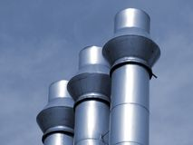 Industrial pipes. Three industrial pipes, blue toned Royalty Free Stock Images