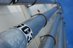 Industrial Pipes. Fill pipes for a chemical stock tank Royalty Free Stock Photo