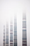 Industrial pipes. Air pollution by smoke coming out of  factory chimneys Royalty Free Stock Image