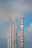 Industrial pipes. Air pollution by smoke coming out of  factory chimneys Stock Photography
