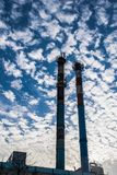 Industrial pipes on the sky background. Industrial pipes on the blue sky background Royalty Free Stock Photo