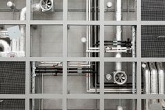 Industrial pipes and fans on ceiling Royalty Free Stock Photos