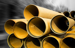 Industrial Pipes. Large industrial construction yellow pipes Royalty Free Stock Photos