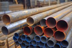 Industrial pipes. Steel industrial pipes on warehouse royalty free stock photography