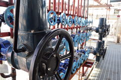 Industrial pipes and valves. Pipeline valves for industrial purposes Stock Photography