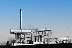 Industrial Piping. Rooftop pipes of industrial processing facility stock photo