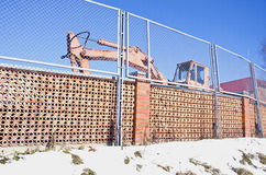 Industrial place fence and old excavator machine Royalty Free Stock Image
