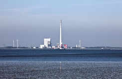 Industrial Plant. This image shows a industrial plant at north sea mudflat royalty free stock photography