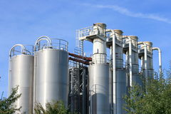 Industrial plant. View of an industrial plant with large aluminum tanks Stock Photos