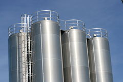Industrial plant. View of an industrial plant with large aluminum tanks royalty free stock image