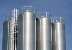 Industrial plant. View of an industrial plant with large aluminum tanks Royalty Free Stock Photos