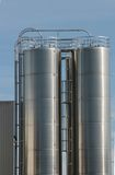 Industrial plant. View of an industrial plant with large aluminum tanks Stock Photo