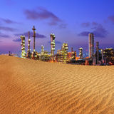 Industrial plant. On desert in sunrise stock photography