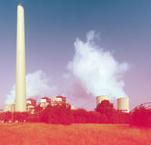 Industrial plant with chimney and cooling towers Royalty Free Stock Images