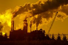 Industrial Plant Emissions. Industrial plant atmospheric emissions silhouette stock photos
