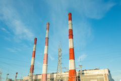 Industrial plant with exhaust pipes Stock Image