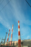 Industrial plant with exhaust pipes Stock Images