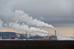 Industrial plant. Exhausting white smoke into the atmosphere Stock Photo