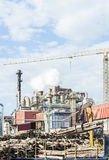Industrial plant of a furniture factory with smoking smokestacks Stock Photography
