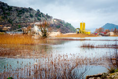 Industrial plant near marshes on a winter cloudy day Royalty Free Stock Photo