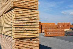 Industrial plant sawmill - storage of wooden boards. Closeup photo royalty free stock image