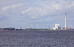 Industrial Plant with Ship. This image shows a industrial plant at north sea with ships stock photo