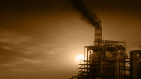 Industrial Plant with Smoke Stacks Billowing Stock Images
