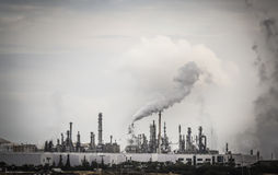 Industrial Plant with Smoke Stacks and Pollution Royalty Free Stock Photography
