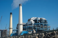 Industrial plant with smoking chimneys Stock Image