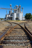 Industrial plant with storage containers and walkways Stock Images