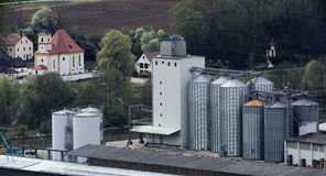 Industrial plants of Dietfurt and church of Griesstetten in the background.  Royalty Free Stock Image