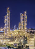 Industrial plants. Petrochemical plant or oil and gas refinery industry and lighting at night time Stock Photos