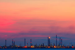 Industrial plants at twilight. Industrial plants lighting up at twilight Royalty Free Stock Photo