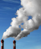 Industrial Pollution. Industrial chimneys discharging smoke, polluting the environment royalty free stock image