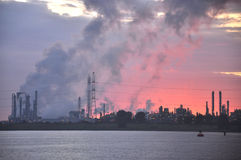 Industrial pollution. Pollution from industrial buildings near the river Stock Photography