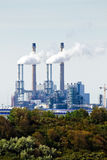 Industrial pollution and trees Royalty Free Stock Images