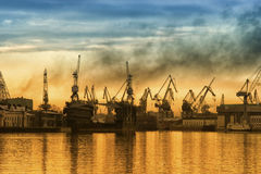 Industrial port. Big city industrial port on a sky background Stock Photos
