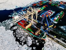 Industrial port with containers in winter, vessel loading Stock Photo