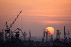 Industrial port dockyard with sunset Royalty Free Stock Images