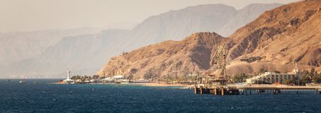 Industrial Port of Eilat, Israel. Marine observatory and aquarium with landscape background Stock Photo