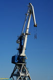 Industrial port large cranes against blue sky Royalty Free Stock Photos