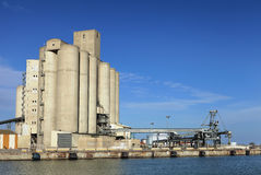 Industrial port with storage silos Stock Images